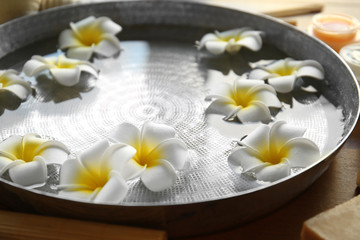 Exotic flowers in bowl with clear water
