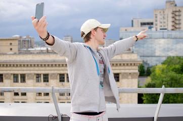 Young man making selfie
