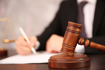 Court hammer on table, closeup