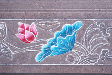 Chinese style painting lotus flowers on temple wall.