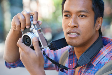 Young man taking picture in NYC neighborhood