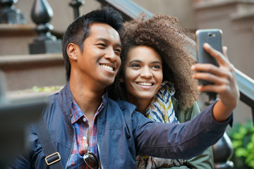 Mixed-race couple taking selfie picture