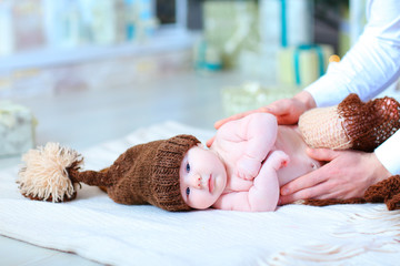 Infant baby lying on blanket in hat with bubo.