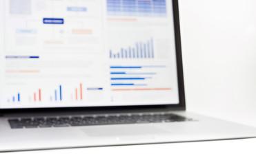 Blur of statistics charts displayed on laptop screen