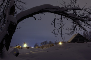 Night and small village in winter snow