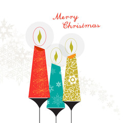 Three colorful Christmas candles with ornaments and snowflakes a