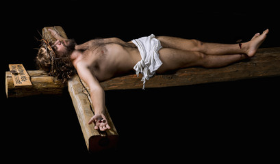 Representation of Jesus Christ nailed to the wooden cross