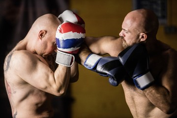 Thai boxers practicing boxing