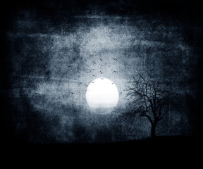Scary halloween dark wallpaper with moon and tree. Scratched blue grunge background