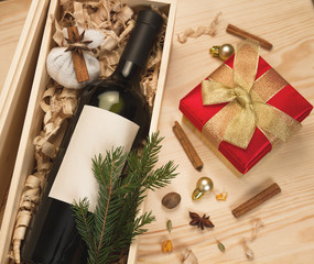 Wine bottle in wooden box and spices for mulled wine