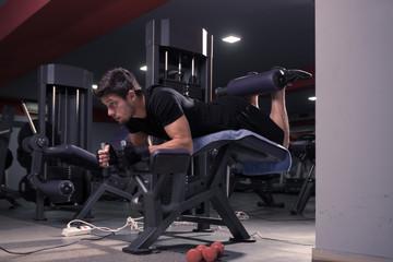 man Leg Curl gym indoors