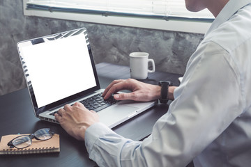Close up of Businessman working on Laptop on the desk.