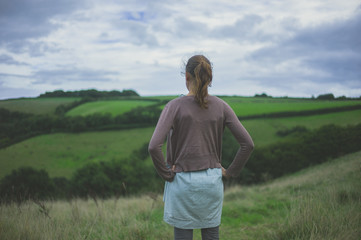 Young woman standing in countryside