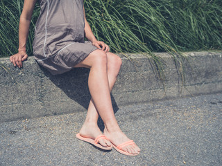 The legs of a young woman sunbathing