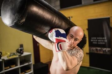 Boxer carrying punching bag