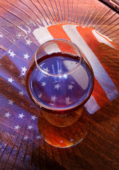 american flag reflected in the glass of whiskey