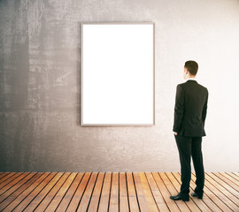 Businessman looking at blank frame