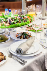 Elegant white banquet and dinner tables prepared for a holiday or a party