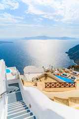 View of sea and and typical Greek boutique hotel with swimming pool in Imerovigli village, Santorini island, Greece