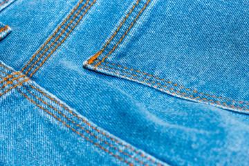 Blue jean or denim on wooden desk,make pattern background,make from cotton,back of jean,bag of jean