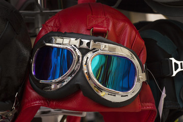 Red vintage leather motorcycle and aviator helmet hat with googles