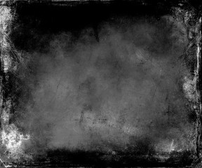 Beautiful abstract vintage grunge background with faded central area for your text or picture, scratched black background