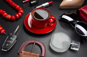 Women accessories, clothing, jewelry, cosmetics and cup of coffee on leather black background, lifestyle, modern female concept, fashion industry