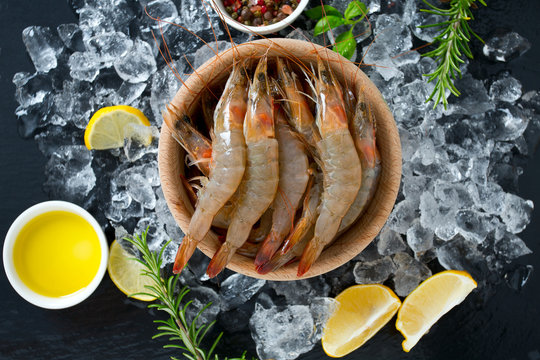 resh raw prawns on dark gray kitchen table