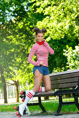 Woman on the roller-skate in the park