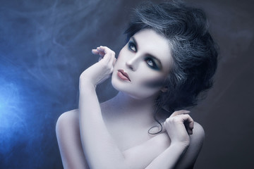 Woman with creative makeup and body-art