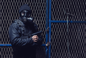 The terrorist with gas mask and gun