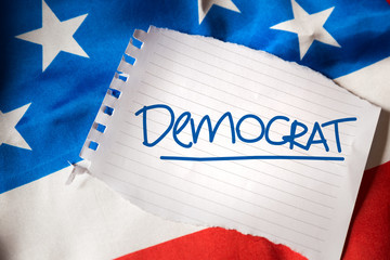 Democratic on notepaper and the US flag