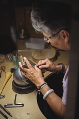 Craftswoman working in workshop