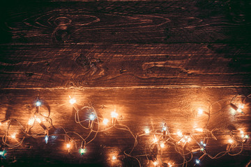 Wall Mural - Christmas lights background. Merry christmas (xmas) background. Old wood texture - vintage styles