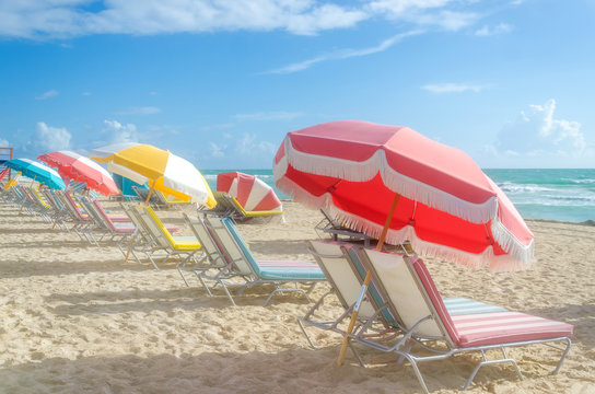 Colorful Beach umbrellas/parasols and cabanas near ocean