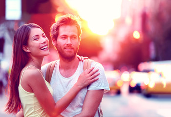 Aufkleber - Happy Asian woman, Caucasian man multiethnic couple relaxing in sunset laughing smiling on urban city street in New York city, USA. Young people in love living a modern lifestyle.