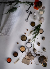 jars of powders, leaves burnt paper, scales on the table. top view