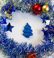 Christmas ornament in silver and blue on white background.
