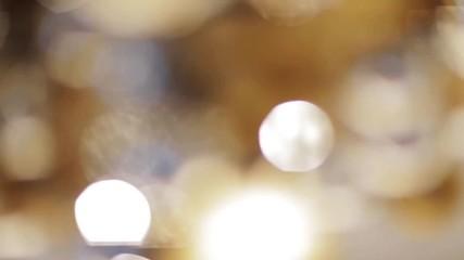 Fotobehang - blurred golden moving christmas lights bokeh