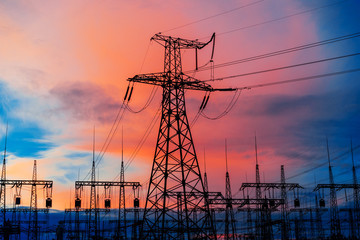 distribution electric substation with power lines and transformers, at a beautiful sunset