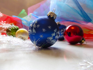 Blue ball on Christmas tree. Beautiful festive greeting card wit