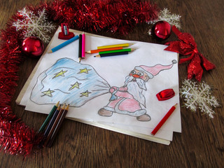 Child's drawing of Santa Claus with a bag of gifts. Celebratory