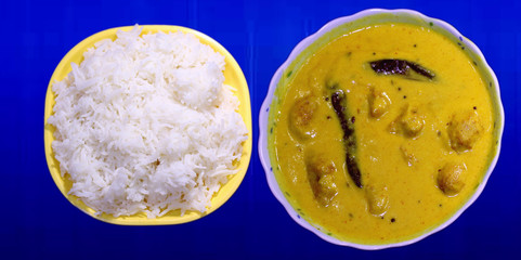 Kadhi Pakoad and cooked rice; a comfort food of most Indian households. Indian cuisine, Indian style food.
