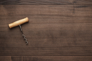 retro wooden corkscrew on the brown table
