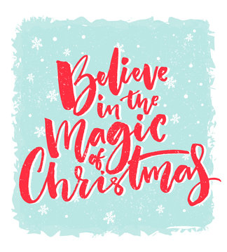 Christmas card design. Believe in the magic of Christmas. Inspirational xmas quote. Red brush calligraphy text on blue background with snowflakes.