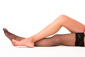 Leg in a black stocking. Lady's legs on white background. Sensuality and femininity. Make an impression on men.