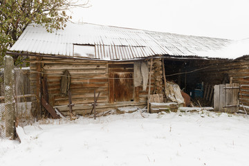 old abandoned wooden shed with a variety of subjects during a sn