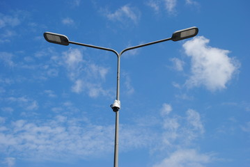 LED street lamps with energy-saving technology, cloud on blue sky daylight background