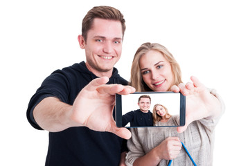 Selfie taken with smartphone by handsome couple