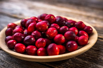 Fresh cranberry on wooden background